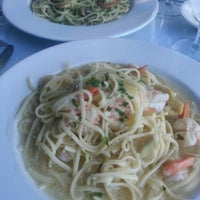 Photo taken at Scampi Pasta House and Bar by Jason A. on 8/2/2013