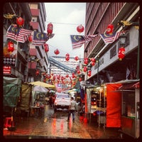 Photo taken at Petaling Street (Chinatown) by J. on 1/11/2013