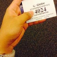 Photo taken at Globe Telecom by Ericson L. on 2/6/2015