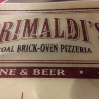 Photo taken at Grimaldi's Coal Brick-Oven Pizzeria by John C. on 2/27/2013