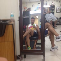 Photo taken at Ron's Barber Shop by David R. on 8/18/2014