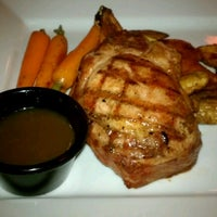 Photo taken at Gusto Grill by Michael R. on 12/2/2012