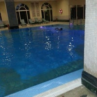 Photo taken at ICF Airport hotel At Pool by Birol G. on 5/7/2014