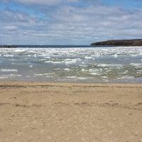 Photo taken at Fish Creek Beach by Matt H. on 5/4/2014