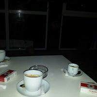 Photo taken at Café Flouka by Oussama A. on 5/22/2014