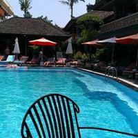 Photo taken at Poolside Wina Holiday Inn Kuta Bali by Josef V. on 3/16/2014