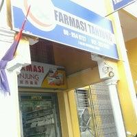 Photo taken at Farmasi Tanjung 丹绒西药房 by Ixxatuls on 12/26/2012