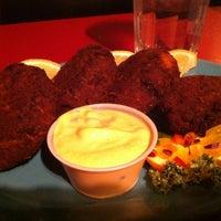 Photo taken at Atomic Cafe by Rob B. on 12/20/2012