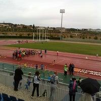 Photo taken at Estadio de Atletismo by Fernando T. on 4/26/2014