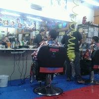 Photo taken at James Master Barber's Shop by Angel L. on 3/21/2014