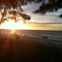 Photo taken at Layang-layangan Beach by 0ldt0keN® on 1/21/2013