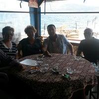 Photo taken at Havuzlu Plaj by Aksel S. on 6/8/2014