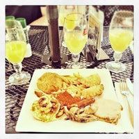 Photo taken at OLV Cafe by Tjay F. on 5/26/2013