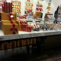 Photo taken at Godiva Chocolatier by Elainebow on 12/1/2012