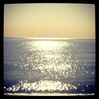Photo taken at Konyaaltı Beach by Єrsin Ş. on 11/19/2012