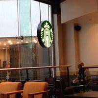 Photo taken at Starbucks Coffee by Ian Maritn A. on 1/20/2014
