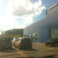 Photo taken at Champion (Peugeot) by Luiz Afonso B. on 12/6/2012