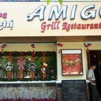 Photo taken at Amigo Grill & Restaurant by Mizugi C. on 12/22/2012