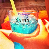 Photo taken at KafePi Beach Club by Kafe Pi S. on 6/24/2014