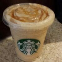 Photo taken at Starbucks by Britt C. on 7/9/2014