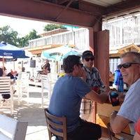 Photo taken at Dockers Waterfront Restaurant & Bar by Nikki L. on 7/10/2014