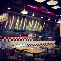 Photo taken at Five Guys by Jerome G. on 3/13/2013