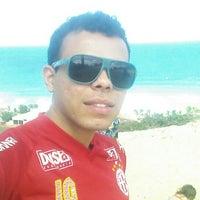 Photo taken at Praia de Búzios by Paulo N. on 12/21/2014