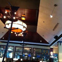 Photo taken at Milestones Grill & Bar by K T. on 9/24/2014
