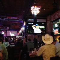 Photo taken at Bikinis Sports Bar & Grill by katsunori k. on 4/25/2012