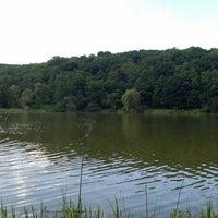 Photo taken at Нижній Голосіївський ставок by Aline A. on 5/25/2014
