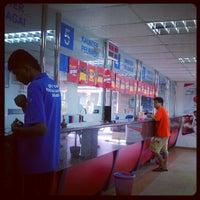 Photo taken at Pejabat Pos (Post Office) by Jynne C. on 12/14/2012