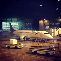 Photo taken at Concourse J by Ivens  L. on 1/11/2013