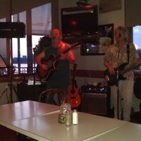 Photo taken at River Cafe & Marina by Johnny R. on 9/2/2013