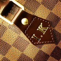 Photo taken at Louis Vuitton Troy Saks by Irene K. on 2/13/2013