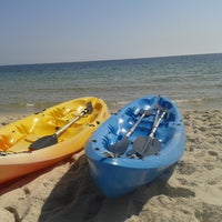 Photo taken at Soussa beach by Ahmed K. on 8/27/2014