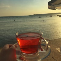 Photo taken at Rıhtım Beach by Medine G. on 9/13/2016