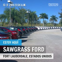 Photo taken at Sawgrass Ford by Freddy A. on 11/13/2014