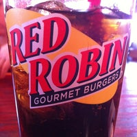 Photo taken at Red Robin Gourmet Burgers and Brews by Erin H. on 12/29/2012