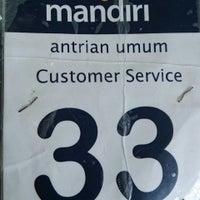 Photo taken at Bank Mandiri by Astutee M. on 10/25/2013