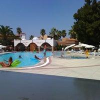 Photo taken at Ephesia Beach Havuz by Erdinç A. on 8/14/2014