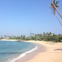 Photo taken at Midigama Beach by Romain C. on 1/18/2014