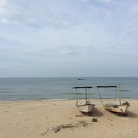 Photo taken at Batu burok beach by Nasrul R. on 7/28/2014