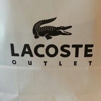 Photo taken at Lacoste Outlet by Eric H. on 5/22/2013