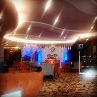 Photo taken at D'Breeze Lounge by Agung Richard Elvon S. on 12/24/2014