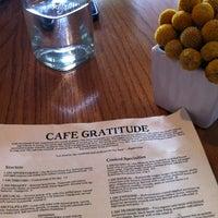 Photo taken at Café Gratitude by Sara R. on 12/16/2012