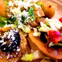 Photo taken at Uno Dos Tacos by Kevin C. on 9/12/2014