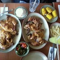 Photo taken at Nando's by Akey on 10/5/2012