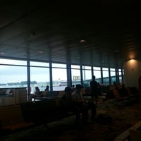 Photo taken at Gate C20 by Travis Joseph De Souza on 6/8/2012