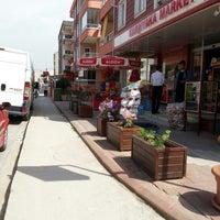 Photo taken at Karşıyaka Market by Ahmet T. on 5/7/2015