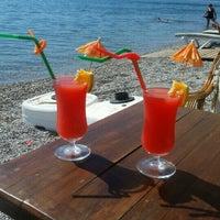 Photo taken at Artemis Beach by Ferhat Ö. on 9/28/2016